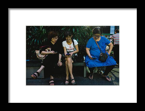Telephone Framed Print featuring the photograph People Using Cellphones by Neo Chee Wei