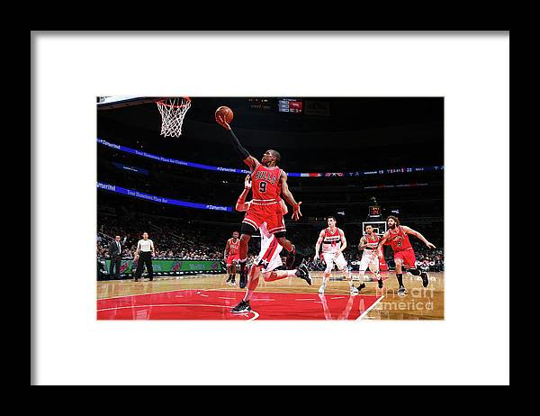 Nba Pro Basketball Framed Print featuring the photograph Rajon Rondo by Ned Dishman