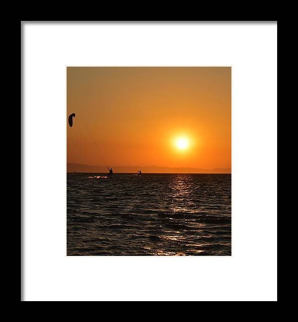 Kitesurfing Framed Print featuring the photograph Red sea sunset by Luca Lautenschlaeger