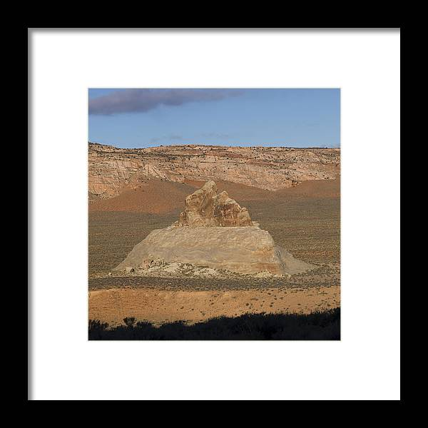 Shadow Framed Print featuring the photograph Rock formations in a desert by Fotosearch