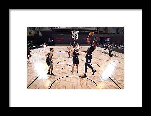 Nba Pro Basketball Framed Print featuring the photograph Sacramento Kings v Miami Heat by Garrett Ellwood