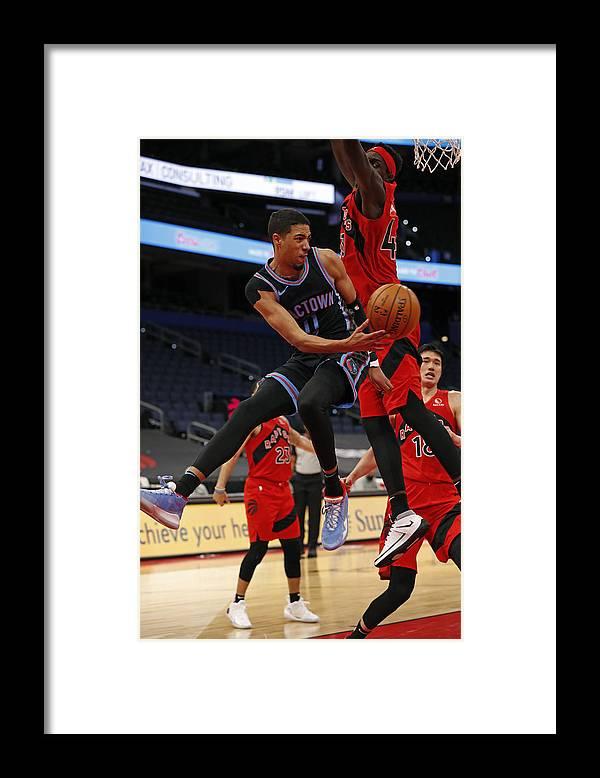 Nba Pro Basketball Framed Print featuring the photograph Sacramento Kings v Toronto Raptors by Scott Audette