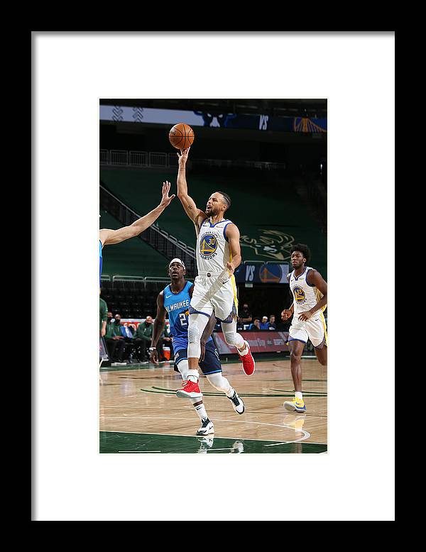 Nba Pro Basketball Framed Print featuring the photograph Stephen Curry by Gary Dineen