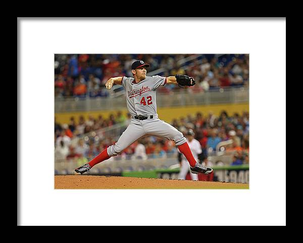 American League Baseball Framed Print featuring the photograph Stephen Strasburg by Mike Ehrmann