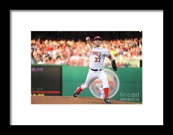 Stephen Strasburg Framed Print featuring the photograph Stephen Strasburg by Rich Pilling