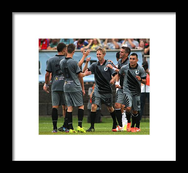 Scoring Framed Print featuring the photograph Swansea City v Minnesota United FC by Andy King