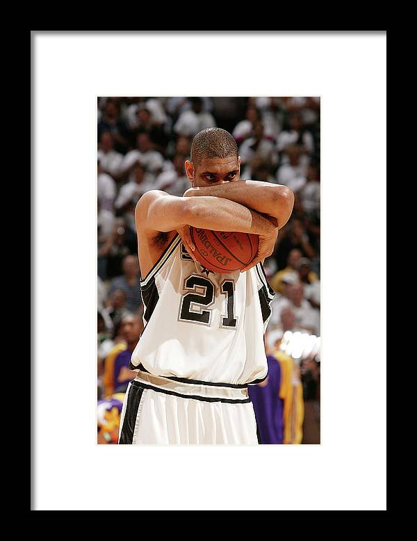 Nba Pro Basketball Framed Print featuring the photograph Tim Duncan by Garrett Ellwood