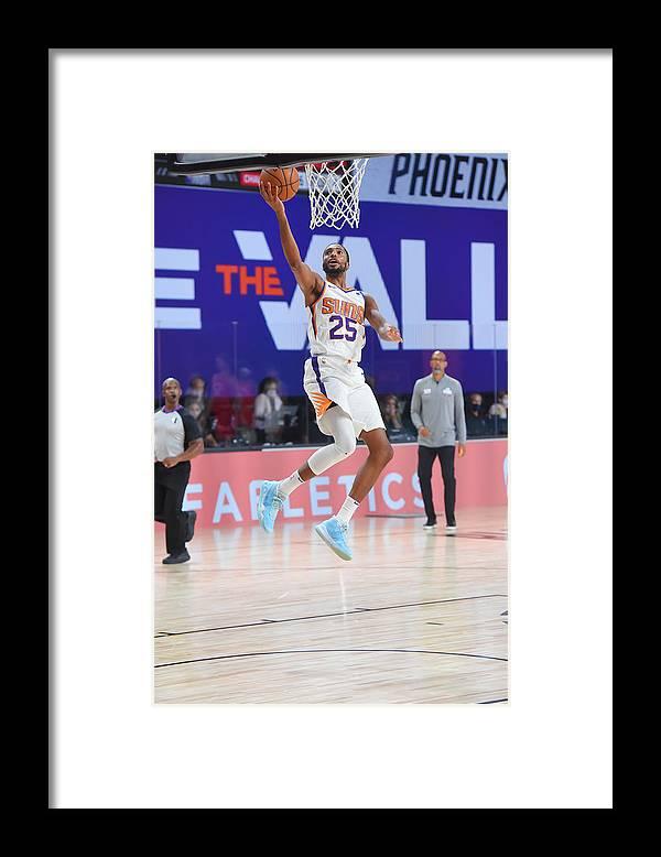 Nba Pro Basketball Framed Print featuring the photograph Toronto Raptors v Phoenix Suns by Bill Baptist