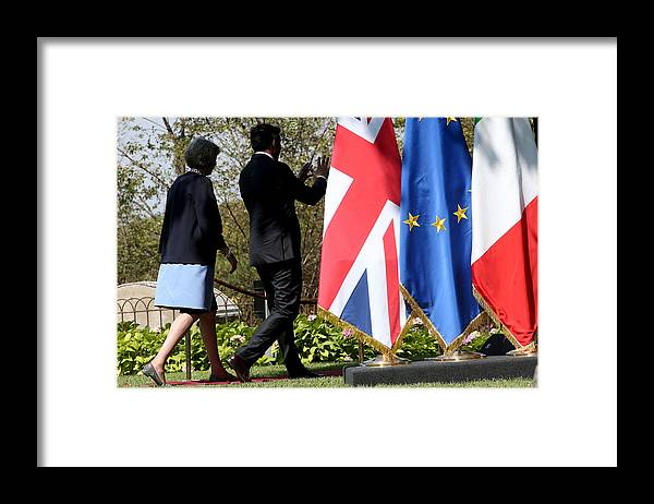 Theresa May Framed Print featuring the photograph UK PM Teresa May Holds Talks With Italian PM Matteo Renzi by Franco Origlia
