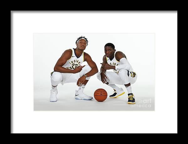 Media Day Framed Print featuring the photograph Victor Oladipo and Myles Turner by Ron Hoskins