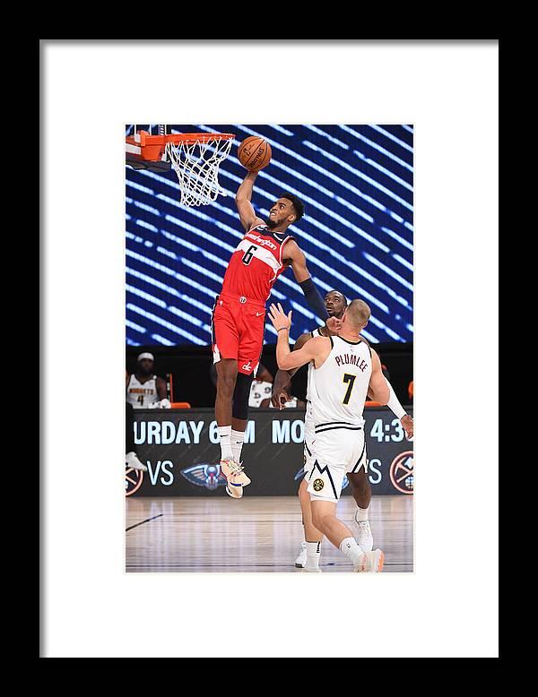Nba Pro Basketball Framed Print featuring the photograph Washington Wizards v Denver Nuggets by Garrett Ellwood