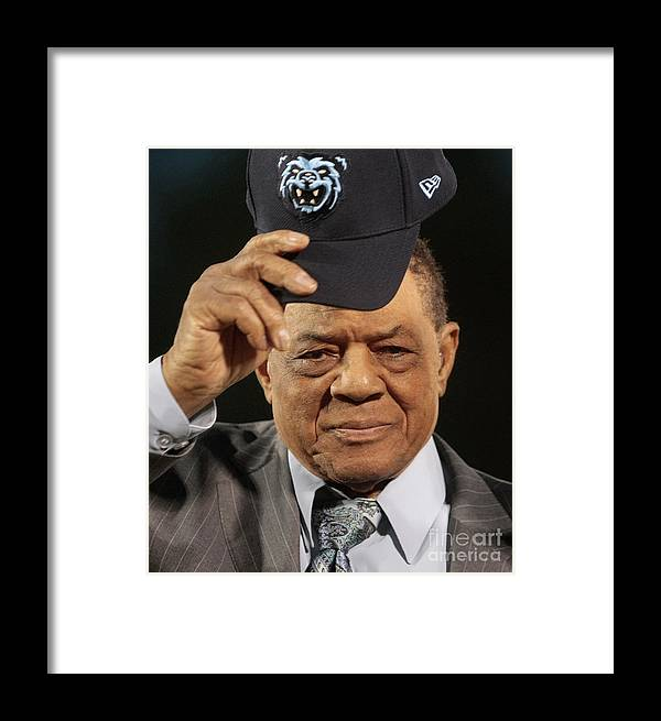 Following Framed Print featuring the photograph Willie Mays And Hank Aaron by Dave Martin