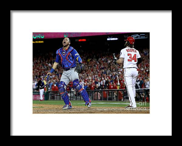 People Framed Print featuring the photograph Willson Contreras and Bryce Harper by Win Mcnamee