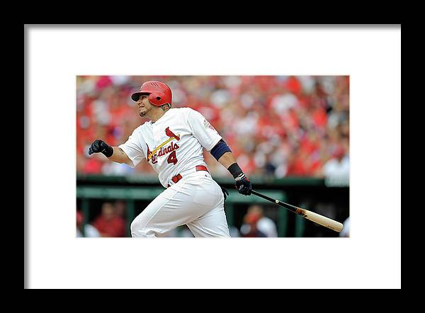 Following Framed Print featuring the photograph Yadier Molina by Jeff Curry