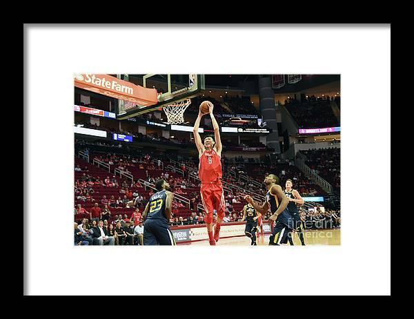 Nba Pro Basketball Framed Print featuring the photograph Zhou Qi by Bill Baptist