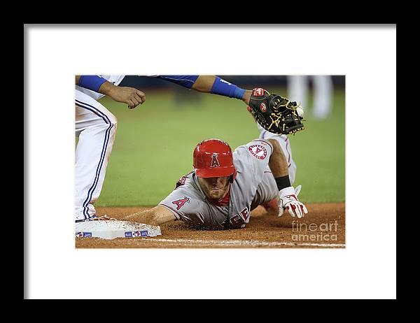 American League Baseball Framed Print featuring the photograph Edwin Encarnacion by Tom Szczerbowski