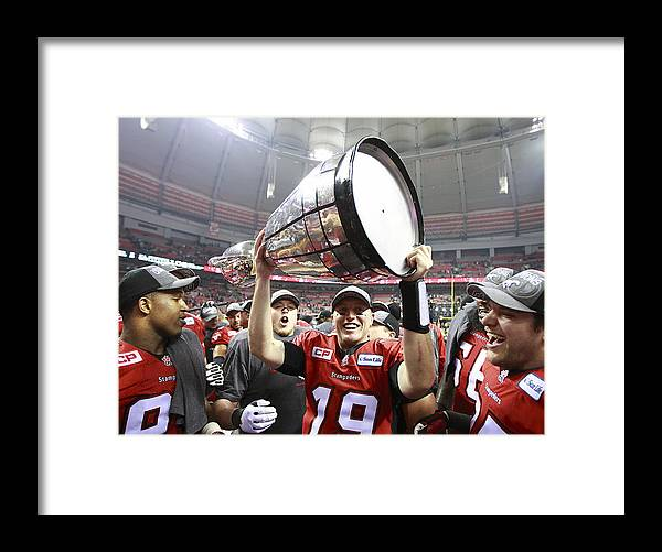 Hoisting Framed Print featuring the photograph 102nd Grey Cup Championship Game by Jeff Vinnick