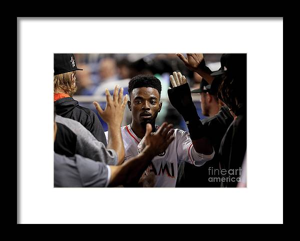 Second Inning Framed Print featuring the photograph Dee Gordon by Mike Ehrmann