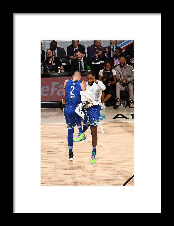 Nba Pro Basketball Framed Print featuring the photograph Lebron James by Garrett Ellwood