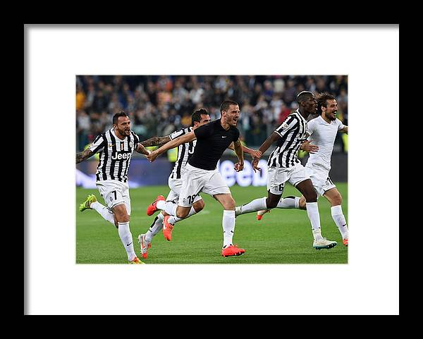 Celebration Framed Print featuring the photograph Juventus v Atalanta BC - Serie A by Giuseppe Bellini