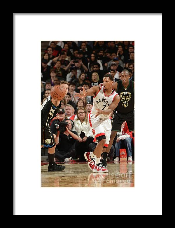 Playoffs Framed Print featuring the photograph Kyle Lowry by Ron Turenne