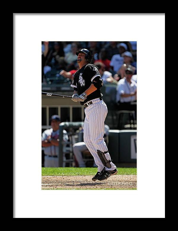Following Framed Print featuring the photograph Paul Konerko by Jonathan Daniel