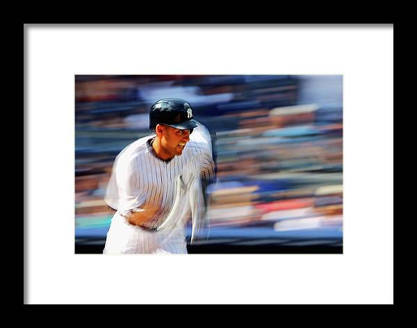 Ninth Inning Framed Print featuring the photograph Derek Jeter by Al Bello