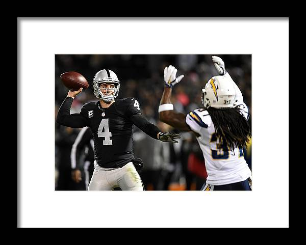 Three Quarter Length Framed Print featuring the photograph San Diego Chargers v Oakland Raiders by Thearon W. Henderson