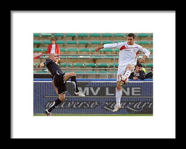 Tommaso Rocchi Framed Print featuring the photograph AS Bari v SS Lazio - Serie A by Giuseppe Bellini