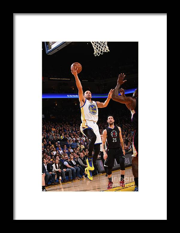 Nba Pro Basketball Framed Print featuring the photograph Stephen Curry by Noah Graham