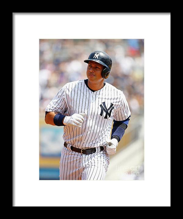 Three Quarter Length Framed Print featuring the photograph Alex Rodriguez, Eric Hosmer, and Chris Young by Al Bello