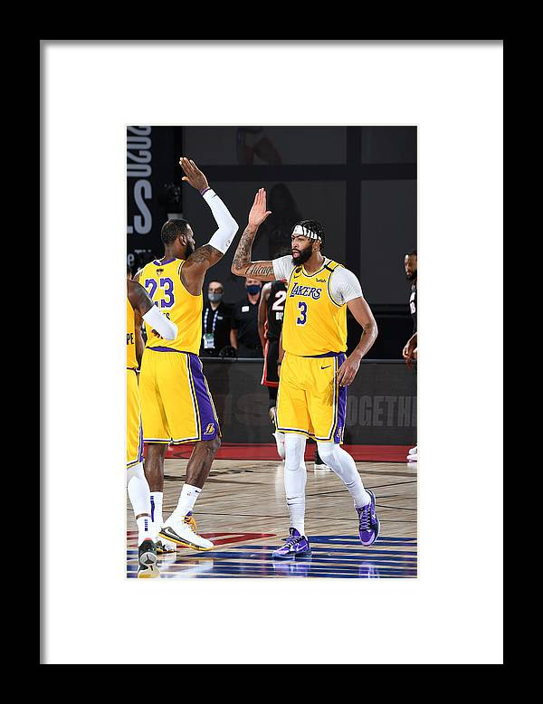 Playoffs Framed Print featuring the photograph Anthony Davis and Lebron James by Andrew D. Bernstein