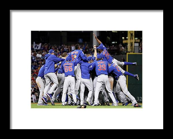 People Framed Print featuring the photograph Anthony Rizzo, Kris Bryant, and Chris Coghlan by Ezra Shaw