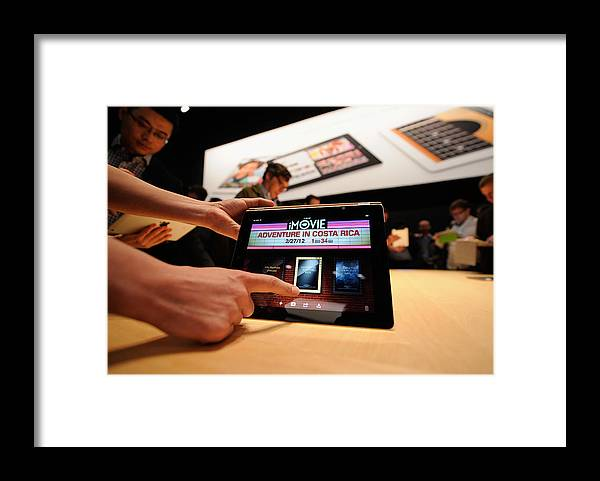 Event Framed Print featuring the photograph Apple Unveils Updated iPad In San Francisco by Kevork Djansezian