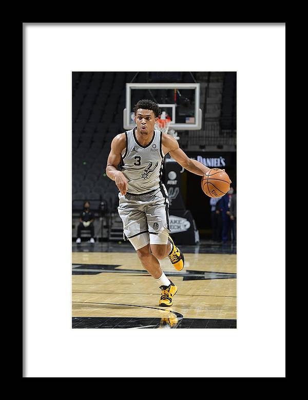 Keldon Johnson Framed Print featuring the photograph Boston Celtics v San Antonio Spurs by Logan Riely