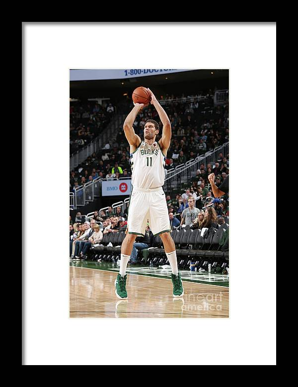 Nba Pro Basketball Framed Print featuring the photograph Brook Lopez by Gary Dineen