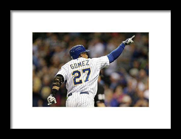 Wisconsin Framed Print featuring the photograph Carlos Gomez by Mike Mcginnis
