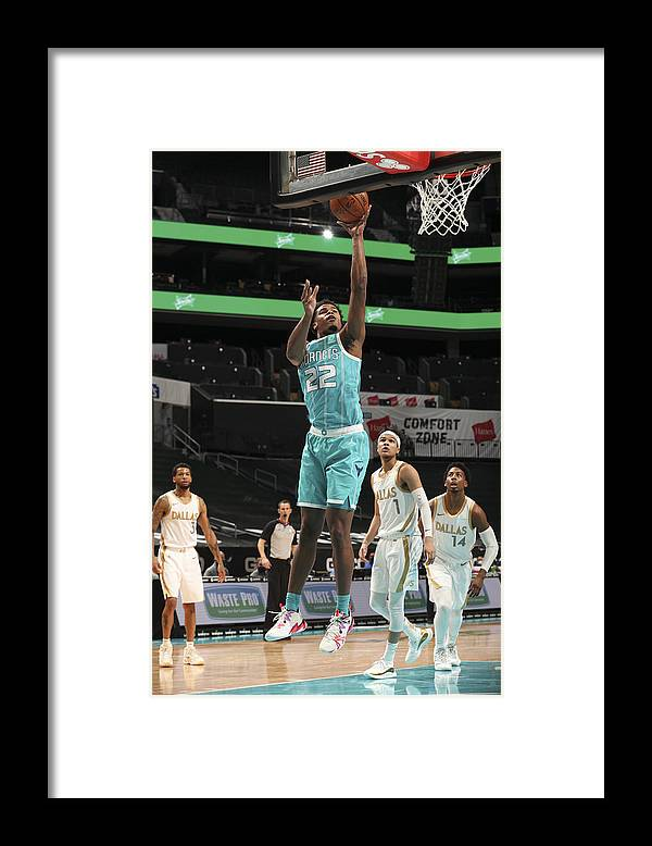 Nba Pro Basketball Framed Print featuring the photograph Dallas Mavericks v Charlotte Hornets by Kent Smith