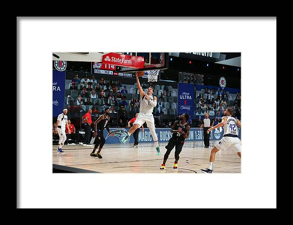 Playoffs Framed Print featuring the photograph Dallas Mavericks v LA Clippers - Game One by David Sherman