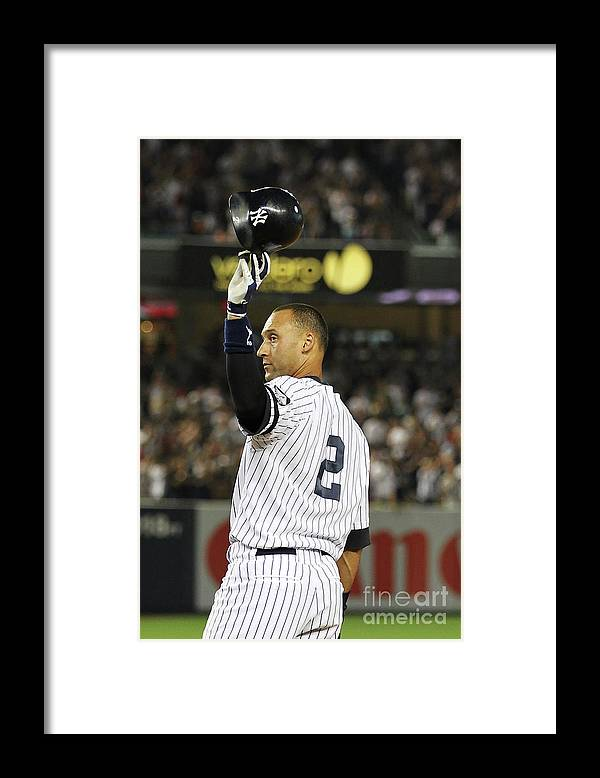 Second Inning Framed Print featuring the photograph Derek Jeter and Babe Ruth by Al Bello