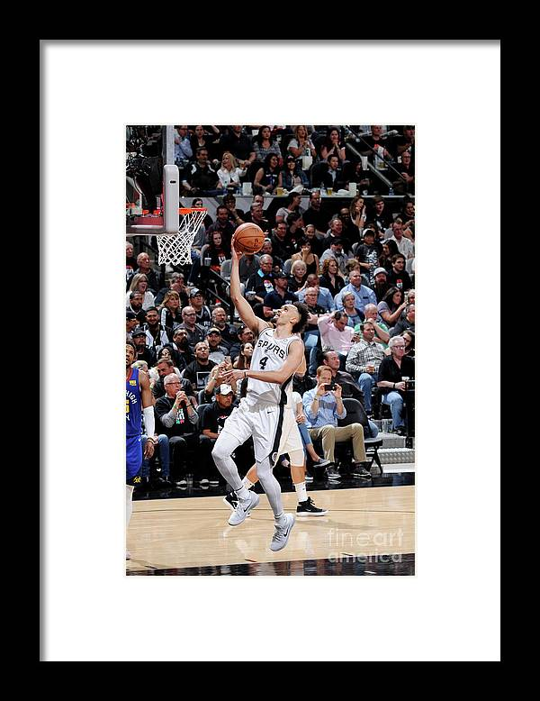 Playoffs Framed Print featuring the photograph Derrick White by Mark Sobhani