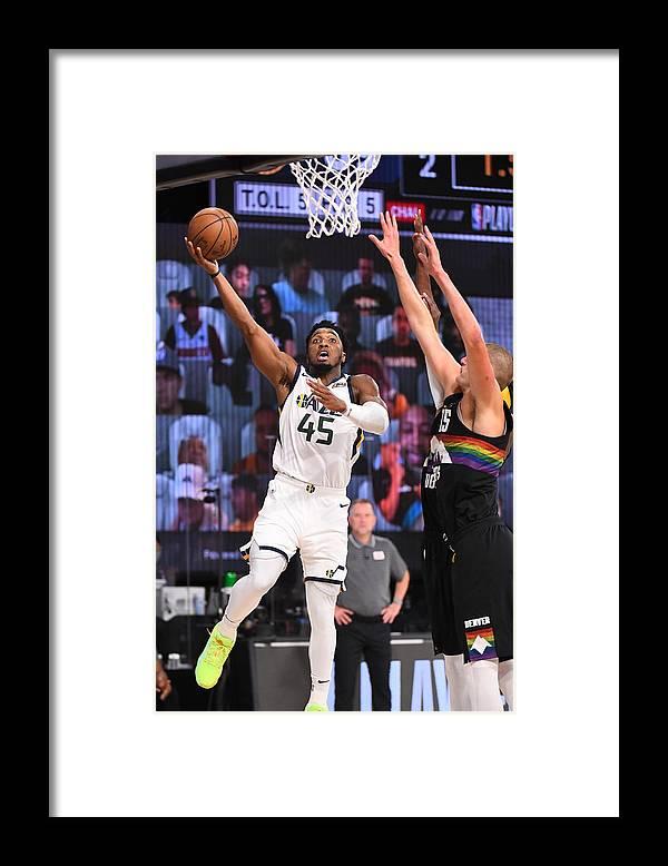 Playoffs Framed Print featuring the photograph Donovan Mitchell by Garrett Ellwood