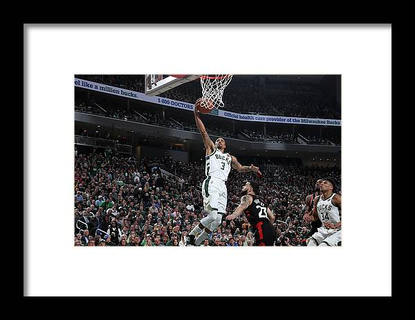 Game Two Framed Print featuring the photograph George Hill by Nathaniel S. Butler