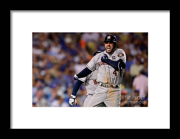 Game Two Framed Print featuring the photograph George Springer by Harry How