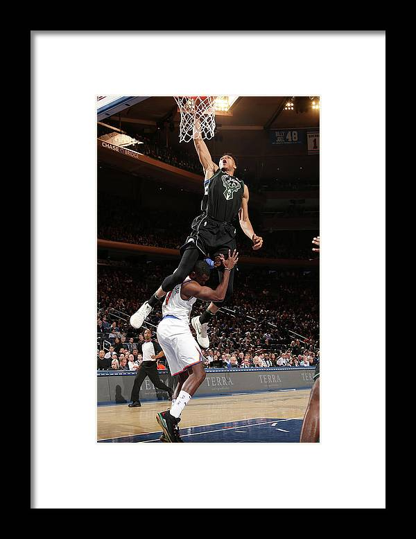Tim Hardaway Jr. Framed Print featuring the photograph Giannis Antetokounmpo by Ned Dishman