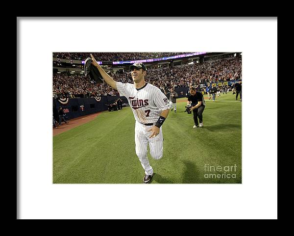 Hubert H. Humphrey Metrodome Framed Print featuring the photograph Joe Mauer by Jamie Squire