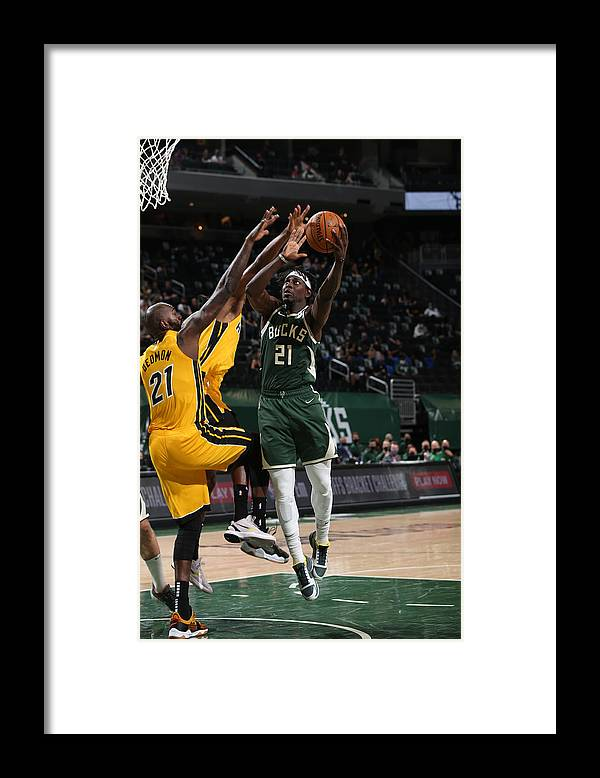 Playoffs Framed Print featuring the photograph Jrue Holiday by Gary Dineen
