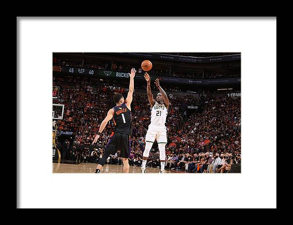 Playoffs Framed Print featuring the photograph Jrue Holiday by Nathaniel S. Butler