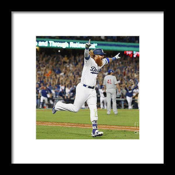 Game Two Framed Print featuring the photograph Justin Turner by Ezra Shaw