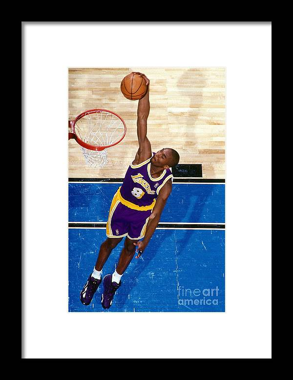 Nba Pro Basketball Framed Print featuring the photograph Kobe Bryant by Nathaniel S. Butler
